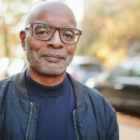 Mature African American Man Smiling Wearing Glasses